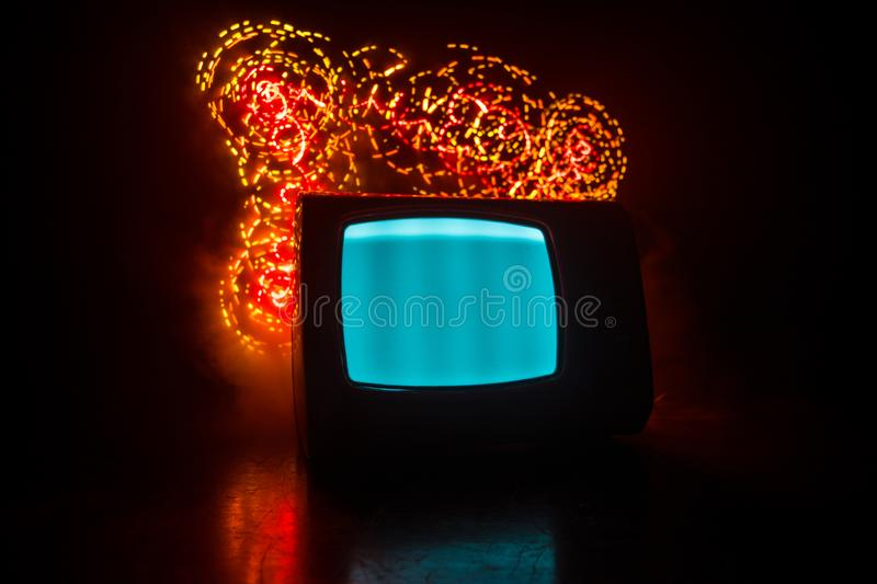 Old vintage red TV with white noise on dark toned foggy background. Retro old Television reciever no signal royalty free stock image