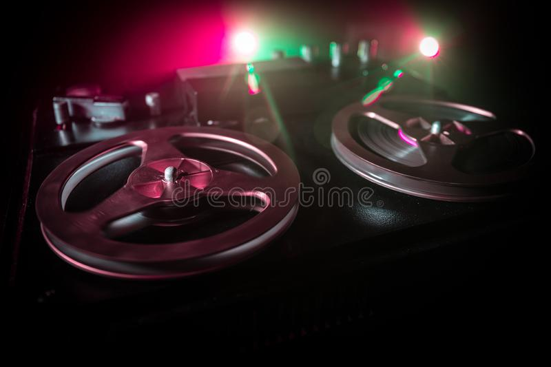 Old vintage reel to reel player and recorder on dark toned foggy background. Analog Stereo Open Reel Tape Deck Recorder Player. With Reels. Selective focus stock photos