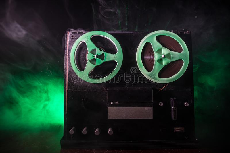 Old vintage reel to reel player and recorder on dark toned foggy background. Analog Stereo Open Reel Tape Deck Recorder Player. With Reels. Selective focus stock images