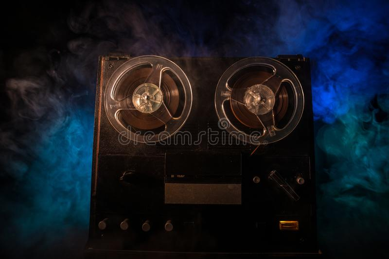 Old vintage reel to reel player and recorder on dark toned foggy background. Analog Stereo Open Reel Tape Deck Recorder Player. With Reels. Selective focus royalty free stock images