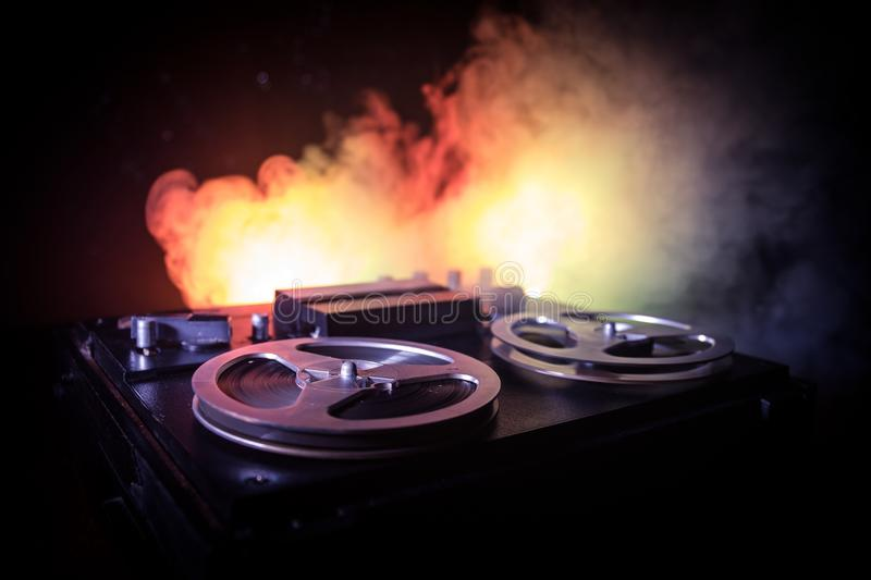 Old vintage reel to reel player and recorder on dark toned foggy background. Analog Stereo Open Reel Tape Deck Recorder Player. With Reels. Selective focus royalty free stock image