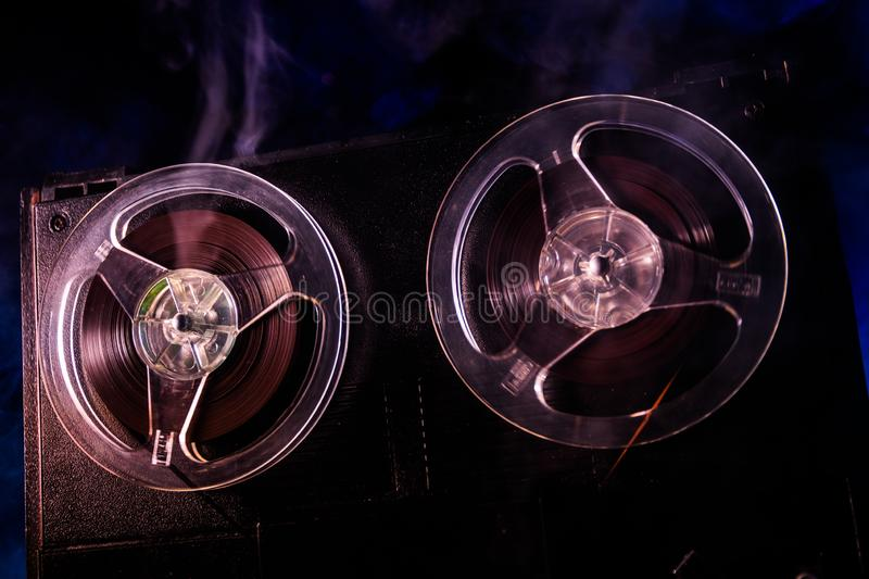 Old vintage reel to reel player and recorder on dark toned foggy background. Analog Stereo Open Reel Tape Deck Recorder Player. With Reels. Selective focus royalty free stock photos