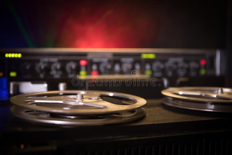 Old vintage reel to reel player and recorder on dark toned foggy background. Analog Stereo Open Reel Tape Deck Recorder Player royalty free stock photo