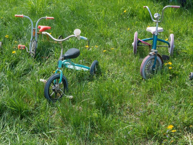 Old vintage retro child bicycles royalty free stock photos