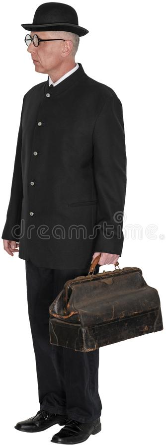 Old Vintage Country Doctor Isolated. Old vintage retro country medical doctor. The man prescribes medicine to ailing patients. Carrying black bag. Isolated on stock photo