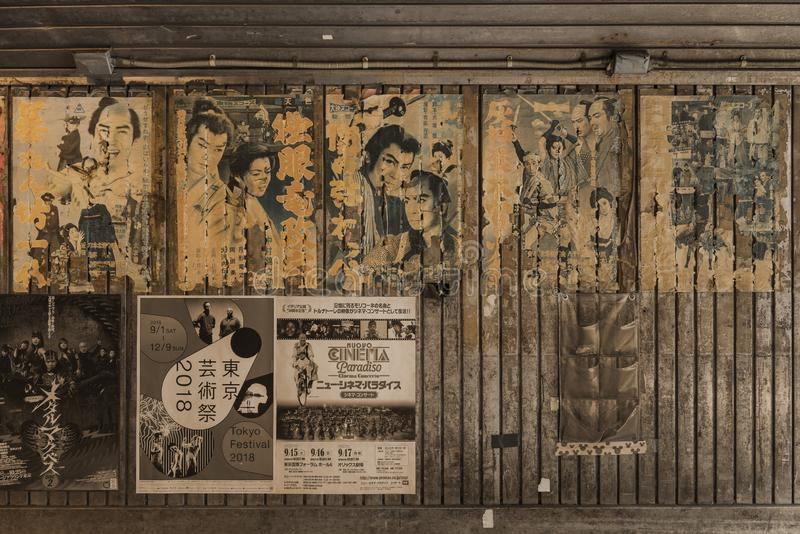 Old vintage retro japanese movie posters on underpass Yurakucho. Concourse wall under the railway line of the station Yurakucho. Japanese noodle stalls and sake royalty free stock photos