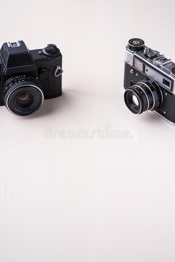 Old vintage retro single black photo film camera copy space angle view on white background royalty free stock image