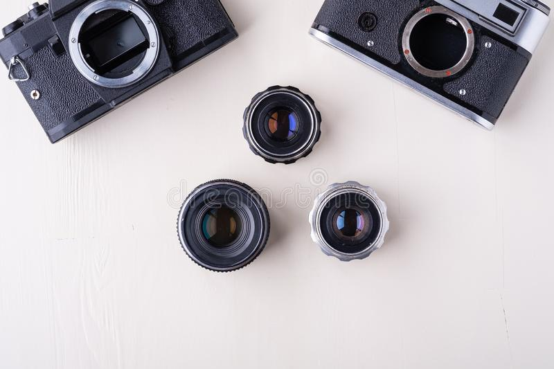 Old vintage retro two photo film camera with three lens copy space top view flat lay on white background stock photo