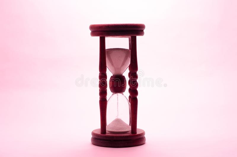 Old vintage retro wooden hourglass on white background stock images