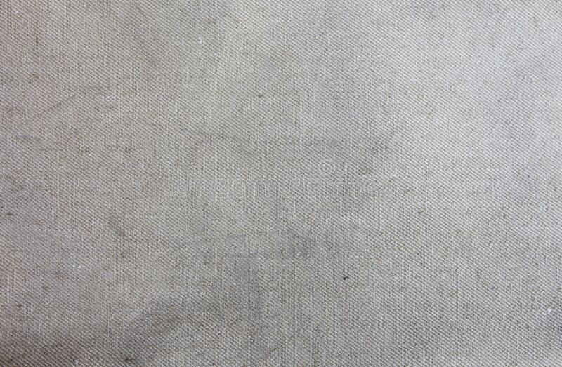 Old vintage rustic linen cloth textile texture background.  stock photo