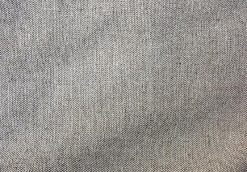 Old vintage rustic linen cloth textile texture background.  royalty free stock image