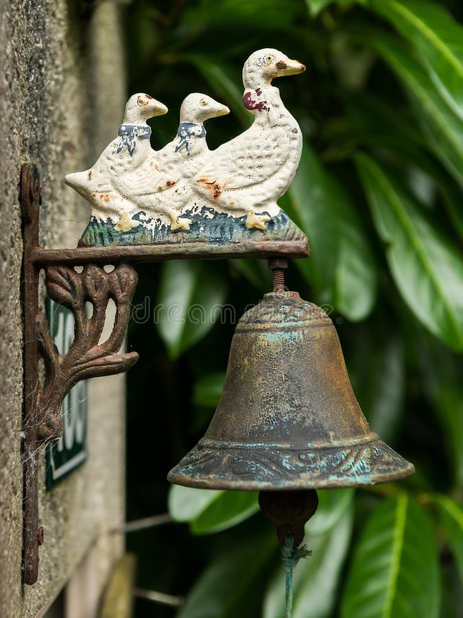 Old vintage rusty doorbell with three ducks stock photography
