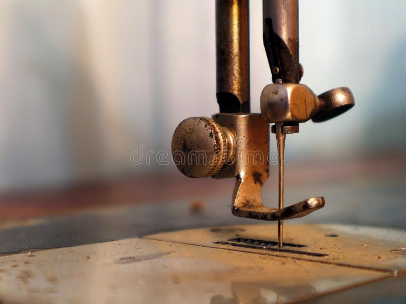 Old vintage sewing machine. Presser foot of an old sewing machine royalty free stock photo