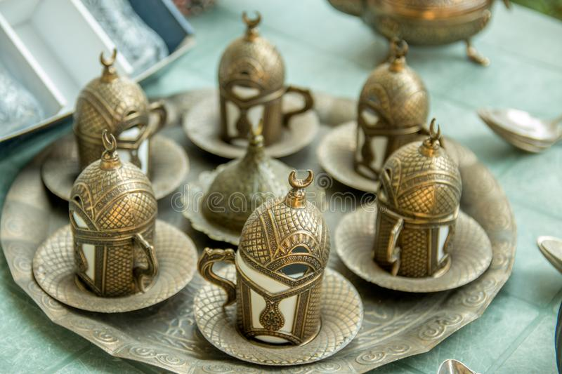 Old vintage silver tableware or tea cup set. royalty free stock photos