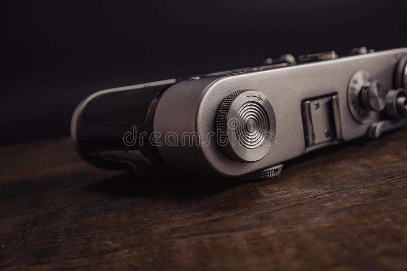 Old vintage soviet camera with lens on wooden background. Voronezh Russia 02.02.2019 old vintage soviet camera with lens on wooden background film antique retro stock photo