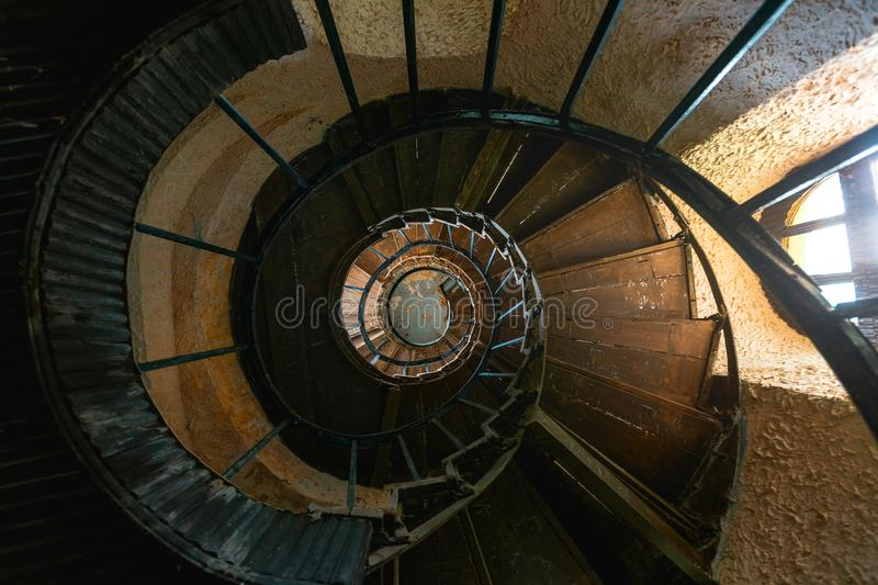 Old Vintage Spiral Staircase In Abandoned Mansion House. Top View royalty free stock photo