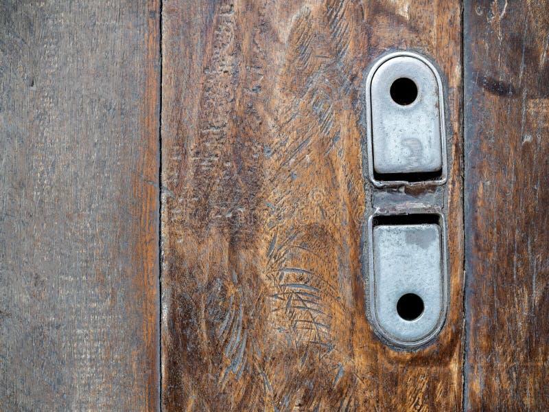 Old vintage steel lock of garage roll door on wooden floor royalty free stock photo