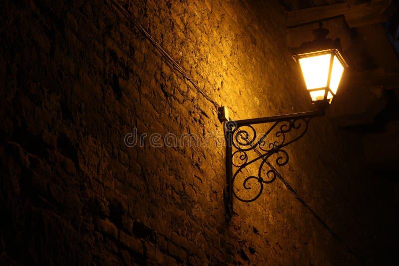 Old vintage street lantern on a brick wall, night background, victorian vintage style stock photos