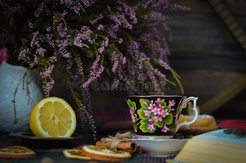 Old vintage tea cup on wooden rustic background stock photography