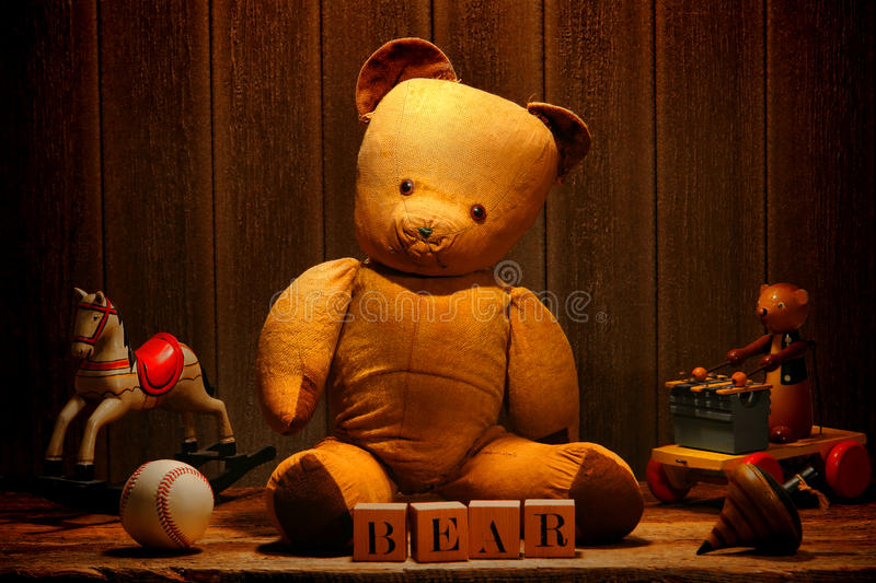 Old Vintage Teddy Bear and Antique Toys in Attic royalty free stock photos