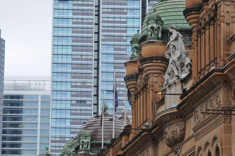 Old vintage townhall in front of high-rise hitech office buildings. In Sydney Australia. This shows a contrast and blending between the old world and the modern stock images