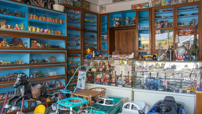 Old vintage traditional Asian toy shop with doll winding, zinc doll, cars toy, rocking horse and mask toy for toy collectors. royalty free stock photos