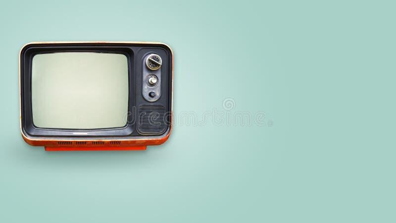 Old vintage tv on color background. retro technology. Retro television - old vintage tv on color background. retro technology. flat lay, top view hero header stock photo