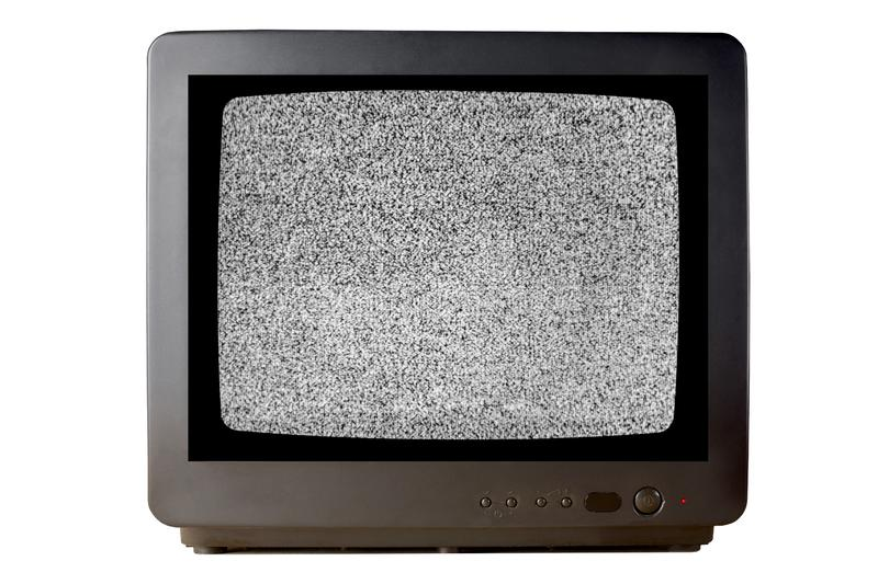 Old vintage TV set televisor isolated on white background with no signal television grainy noise effect on the screen.  royalty free stock images