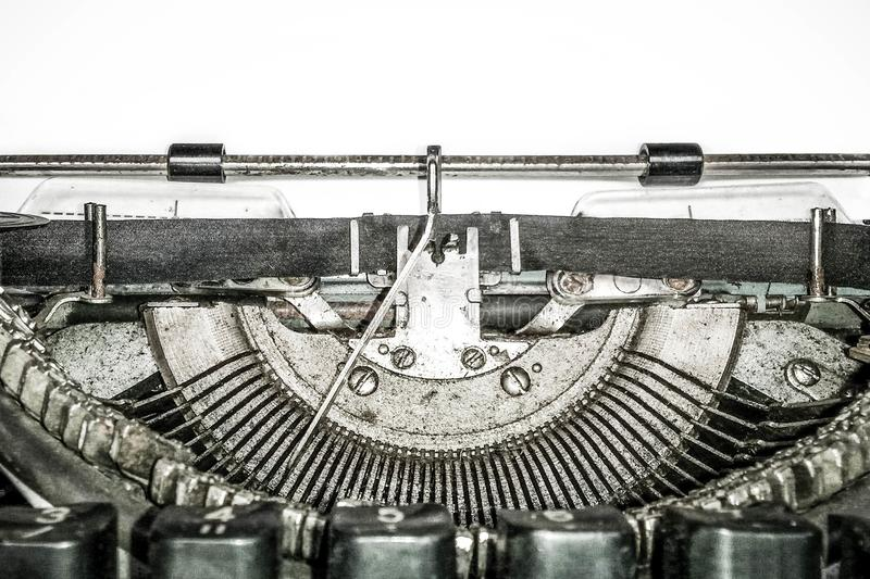 Old vintage typewriter, retro machine with white sheet of paper, copy space, close up.  stock photo