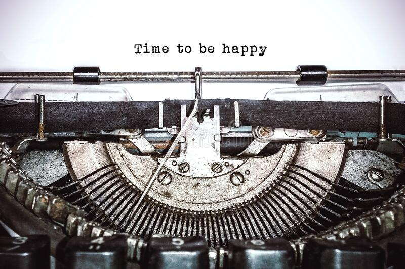 Old vintage typewriter, retro machine with white sheet of paper and typed text. `time to be happy`, copy space, close up stock images