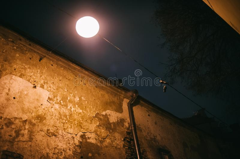 Old vintage Vilnius old town wall with bright street lantern royalty free stock image