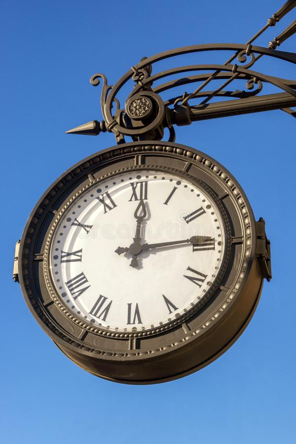 Old vintage wall clock in St. Petersburg stock image