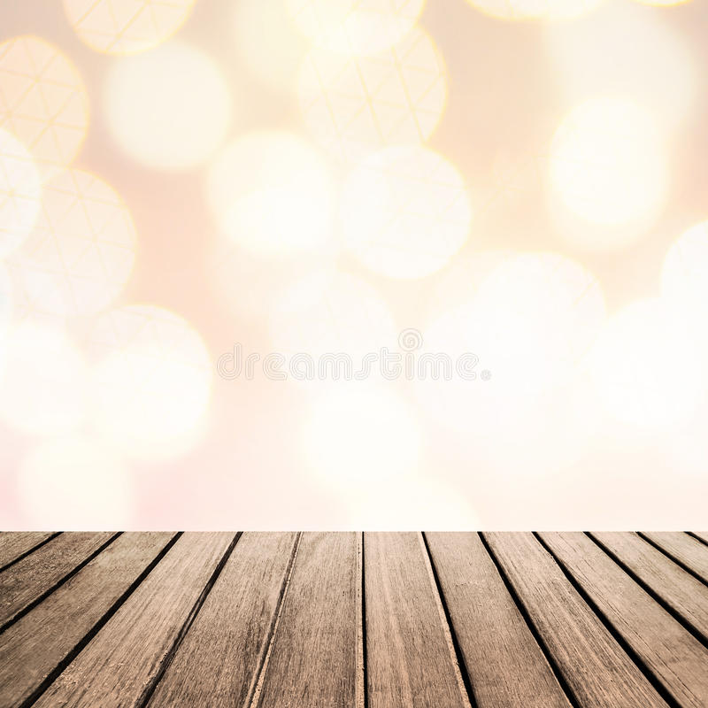 Old vintage wood panel tabletop with Blurry sparkle glitter bok stock image