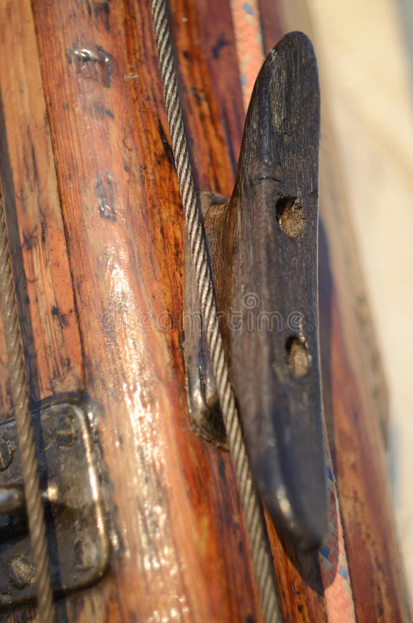 Old vintage wooden cleat on the mast, yacht equipment royalty free stock photos