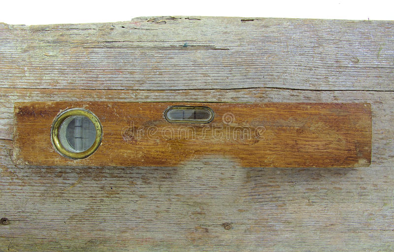 Old vintage wooden water level on wood stock photos