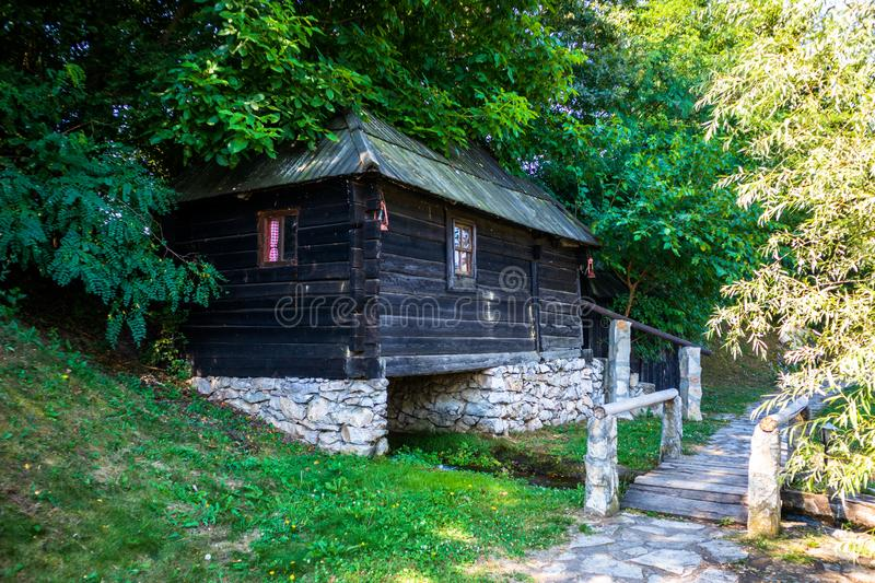 Old vintage wooden water mill royalty free stock photo