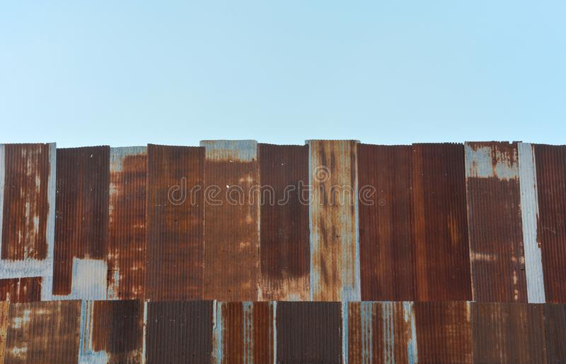 Old, vintage zinc sheet galvanized sheet texture with blue sky background. Copy space royalty free stock photo