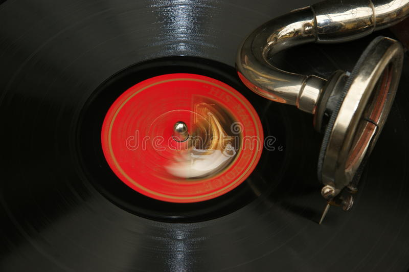 Old vinyl LP (78s) vinil playing. The vintage vinyl ron an old record player (moved creative stock image