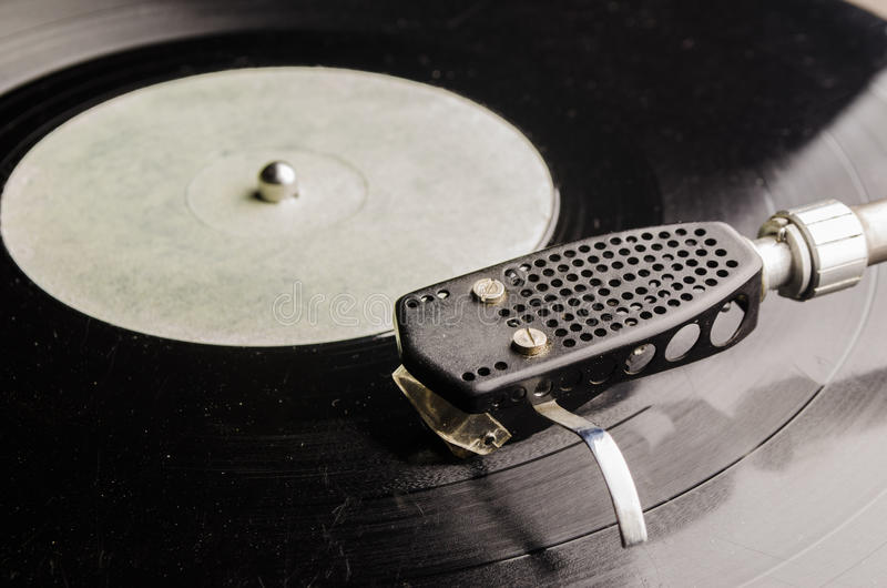 Old vinyl record. Old black vinyl record in the player stock images