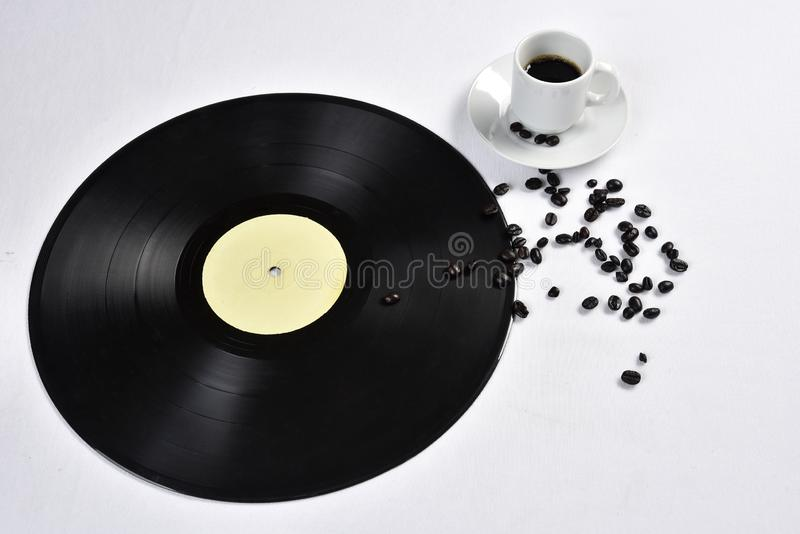 Old vinyl record with coffee.  royalty free stock photography