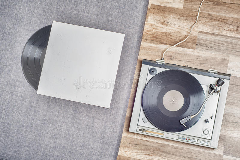 Old vinyl record and turntable stock photo