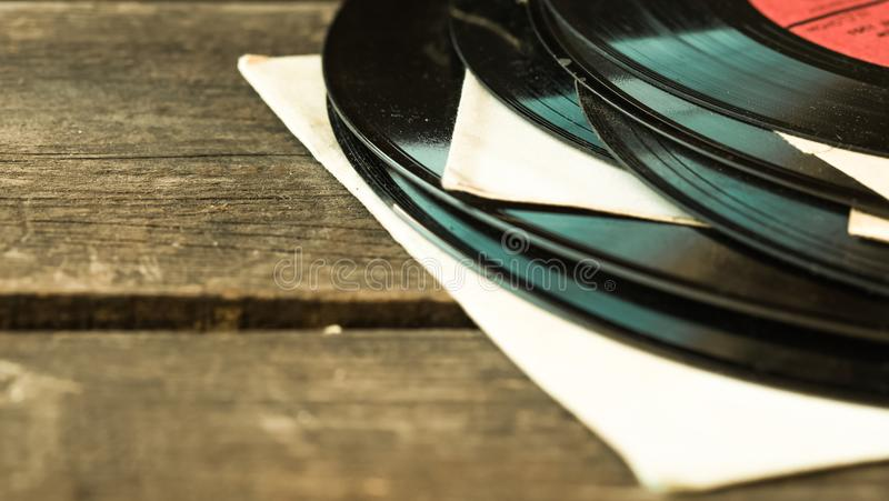 Old vinyl record. On the wooden table, selective focus stock photos