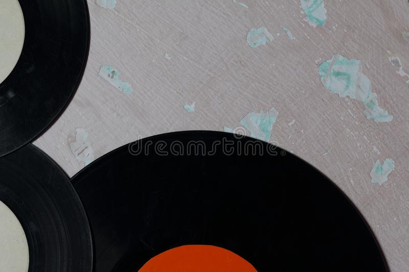 Old vinyl records. Worn and dirty. Lie on the surface with peeling paint stock photography