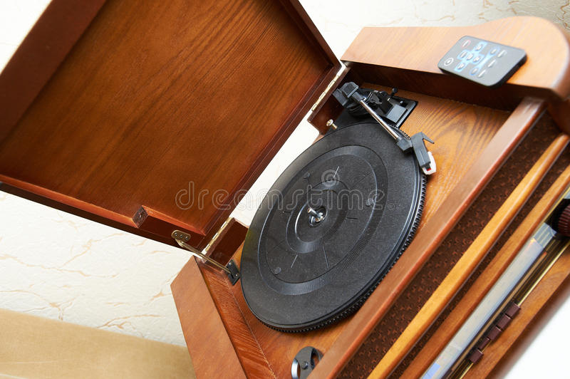 Old vinyl wooden record-player. And remove control stock image