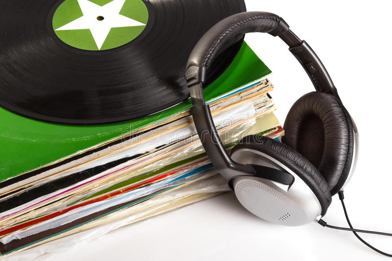 Old vinyls and headphones. Gramophone records and headphones . Old vinyls royalty free stock images