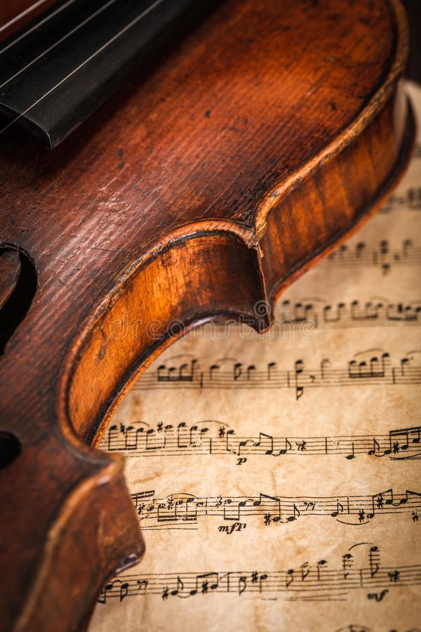 Violin detail with score stock photography