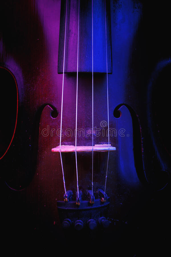 Old Violin Illuminated in Blue and Purple royalty free stock photos