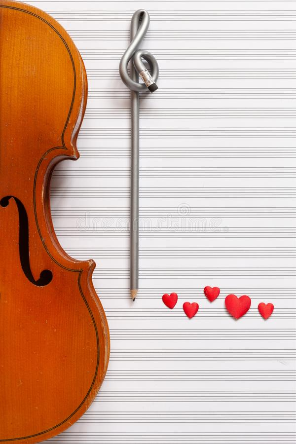 Old violin, pencil treble clef shape and red heart figurines. Top view, close up, flat lay on white music paper background.  vector illustration