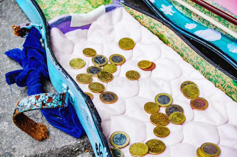 Old violin tray with donated euro coins royalty free stock photos