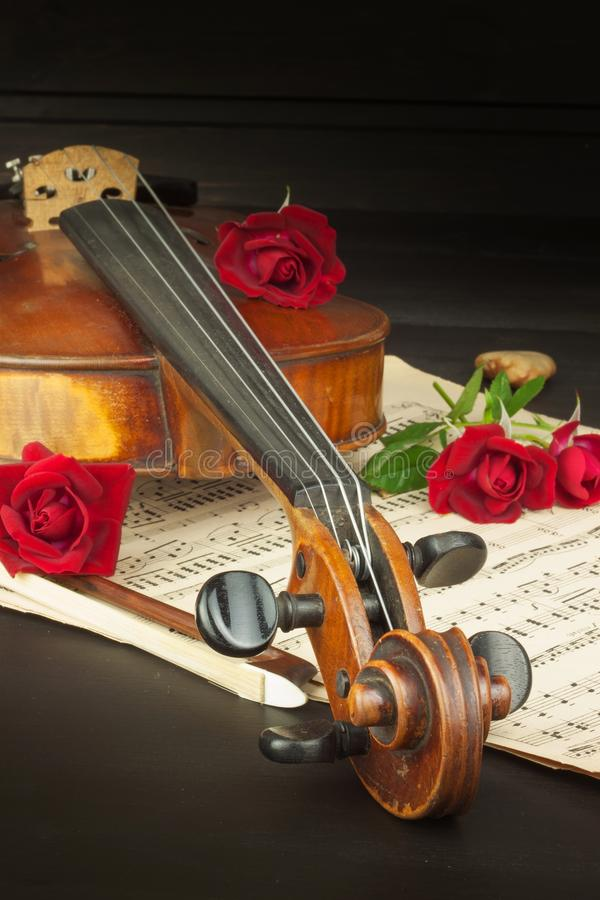 Old violin on wooden table. Detail of old violin. Invitation to the Violin Concerto. I love classical music. Sale of antique stock photo